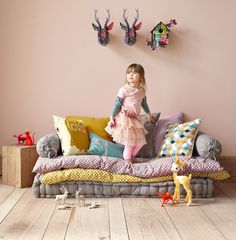 Kid blanket couch, cute for a little girls room.