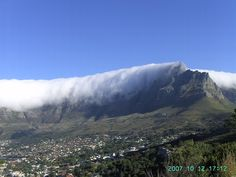 Table Mountain in the clouds. (Credit: ijshoorn). Table Mountain near Cape Town, South Africa was the inspiration for Lacaille's constellation Mensa. The Large Magellanic Cloud represents the clouds often seen on the mountaintop.