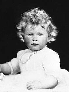 """Only 14 months old, the future Queen Elizabeth II already commands attention as she poses prettily for the camera in 1927. The photo is among those currently on exhibit at the National Portrait Gallery's Diamond Jubilee retrospective of the monarch, which gallery director Sandy Nairne says, [reflects] her long reign and also the respect and affection that is felt towards her."""""""