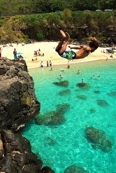 Take a leap off the rock at Waimea Bay! #Hawaii #ocean #waimeabay #jump #experiencehi www.experiencehawaii.com
