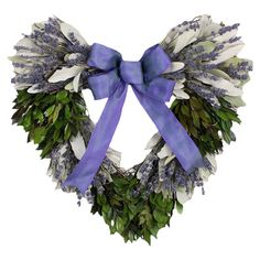 """Preserved Amour Wreath Preserved heart-shaped myrtle wreath with natural lavender and an ombre purple ribbon.  DETAILS Construction Material: Preserved florals, natural twigs and ribbon Color: Green, purple and white Features: Includes preserved myrtle and lavender Dimensions: 16"""" H x 16"""" W x 4"""" D Cleaning and Care: Wipe gently with a dry cloth"""