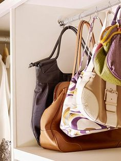 Organizing purses with shower rings and a tension rod. I am slowly building my dream accessories storage space... and after checking out some great Ikea hacks, I think they would all hang nicely in a stand alone (tall and narrow) cabinet (since we're still renters.)  !!!