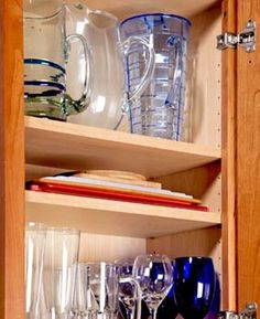 Storage solution: set shelf pegs close together to get extra flat storage for cutting boards, trays and placemats in your kitchen cabinets.