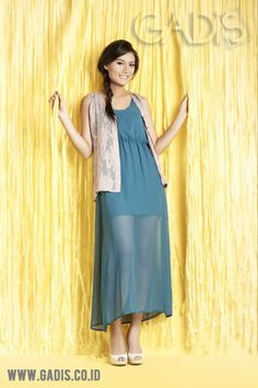 Wearing maxi and mini in one outfit, why not? This sheer maxi dress can make it happen. Flirty!