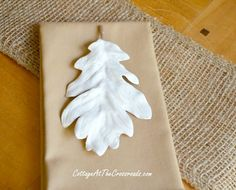These easy-to-make plaster leaves look beautiful on a neutral Thanksgiving table! http://cottageatthecrossroads.com