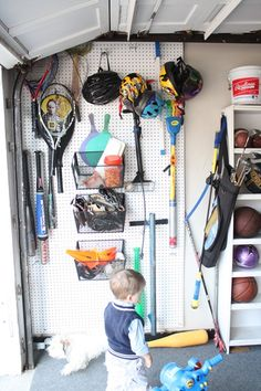 cheapy peg board for all the sports equipment.
