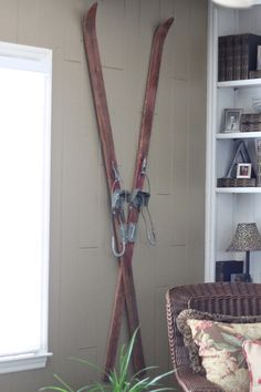 A pair of antique skis warm an otherwise empty living room wall