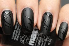 Glossy black design on matte nail art