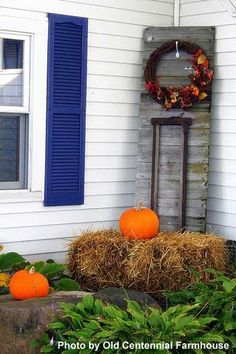 Barn door, with stanchion and a wreath. Good for fall and winter. We have stanchions at the shop, too!