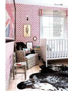 Nursery with graphic wallpaper. Vivienne Westwood Squiggle red and white wallpaper by Cole & Son. As seen in Living Etc magazine.