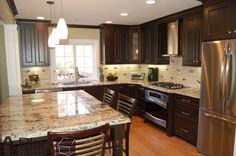 My favorite look: dark cabinets, light granite.