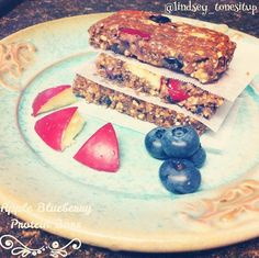 Apple Blueberry Perfect Fit Protein Bars shared by lindsey_tonesitup. Makes 30 bars. 1 cup steel cut oats, 1 cup blueberries, 2 small apples (diced), 1 cup almond butter, 1 cup honey, 1/2 cup chia seeds, 1/3 cup ground flaxseeds, 1/2 cup vanilla Perfect Fit Protein. Mix all ingredients together. Place parchment paper in a 9x13 pan and pour mixture. Press down with a spatula. Stick in freezer for 20-25 minutes until firm then cut into bars. Store extras in freezer until ready to eat!
