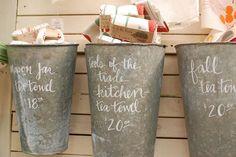 idea for display. love the writing on the buckets!!!! cute idea for a bath room.