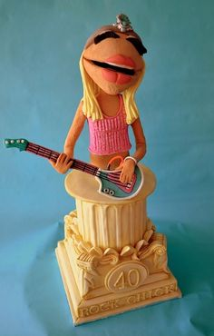 By Sweet Ruby Cakes    This cakey rocker chick is blowing my mind. I want to see a slice out of it somewhere, just to prove it's really cake! (And while you're at it, I'd like a life-sized Swedish Chef cake, too, please. BORK BORK.)
