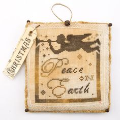 Peace on Earth ornament from the Just CrossStitch Christmas Ornaments issue. Order a print or digital issue here: http://www.anniescatalog.com/detail.html?prod_id=104256