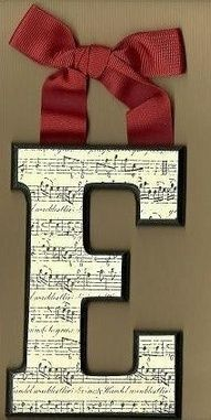 mod podge old sheet music to a wooden letter