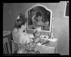 Carmen Miranda at dressing table with her fruit hat, Los Angeles, Calif., circa 1941