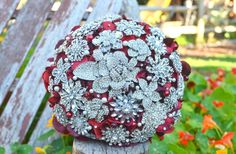 Still into brooch bouquets and this red + silver combo is killin it!