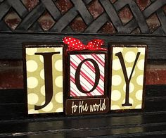"Joy to the world painted blocks, sometimes Christmas becomes too ""Santa'ish"" and we sometimes innocently do that because it's easy to because it's fun, but its all about Jesus's birth and I am so grateful for that!"