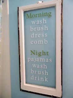 old window into a Bathroom Routine sign