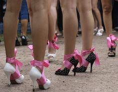 Participants wait for a start of a high heel race in Moscow on July 9,
