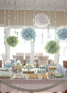 Ideas for baby shower - pompoms over table, glass jars holding sweets, color scheme, and a cute banner on the table. Adorable