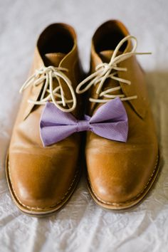 bow tie and shoes, photo by Daphne and Dean http://ruffledblog.com/lighthouse-point-park-wedding #weddingshoes #bowties