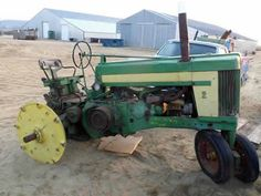 Antique John Deere 620 tractor salvaged for used parts. Call 877-530-4430 for the best selection of used ag parts. http://www.TractorPartsASAP.com