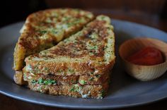 """Crispy Salt and Peper French Toast  Serves 4 to 6  5 eggs  3 tablespoons half-and-half  1 teaspoon salt  2 teaspoons black pepper  1 1/2 tablespoon green onions, finely chopped (optional)  1 1/2 tablespoon cilantro, finely chopped (optional)  vegetable oil  butter  8 (1/2"""") slices day-old bread*, cut on the diagonal"""