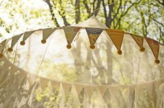 Love the idea of a whimsical outdoor tent under the trees.  Perfect spot for the party food table.