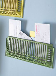 Paint old vent grates and nail them to the wall to organize mail. Saves so much space!