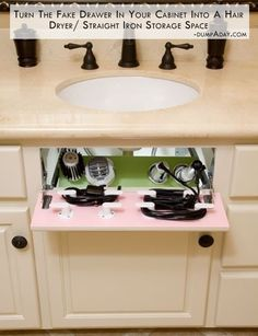 Turn the fake drawer in your cabinet into a hair dryer straight iron storage space