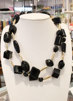 Long necklace of onyx and obsidian beads with gold