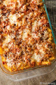 It's a classic! Baked Ziti recipe with ziti pasta, Italian sausage, onions, garlic, Italian seasoning, tomato sauce, Mozzarella, ricotta, and Parm. SO GOOD! On SimplyRecipes.com