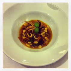 Braised squid in a tomato, chorizo and white bean stew with crispy ...