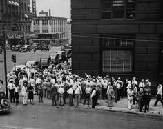 Omahans gather at 17th & Farnam Streets to listen to a radio broadcast of a speech by Adolph Hitler in Nuremberg, Germany in the fall of 1938. THE WORLD-HERALD
