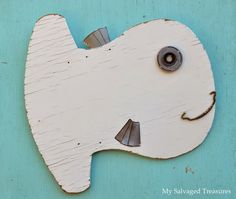 One end of a broken doll cradle gets a new life as a fish.