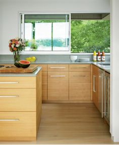 sleek and streamlined modern coastal kitchen. Shop the look in our Coastal Living shop