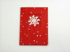 Let It Snow - A beautiful and versatile folded card made from the highest quality coloured card. Its pure solid colour flows through it's surface which features a crisp, original smooth finish. Card is decorated with handmade crocheted snowflake and the finishing touch: printed cellophane. It comes with poppy red envelope in recyclable clear lidded box. Pack of 5.
