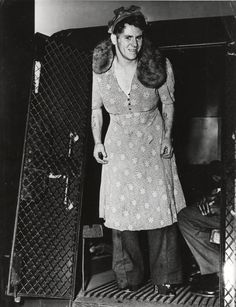 Weegee, Man arrested for cross-dressing, New York, ca. 1939