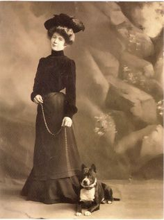 Edwardian woman with her perky Pit Bull.