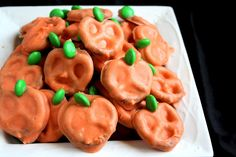 Easy Pumpkin Pretels  •1 bag mini pretzels {you won't use the whole bag, only about 1/4}  •1 bag M's candy, needing only the green ones {fun separating activity for kids!}  •orange food coloring, I used about 1/8th tsp of Wilton's gel colors  •1 bag White Chocolate chips, melted slowly {directions below}  •1 TBSP shortening, to thin out chocolate
