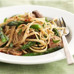 Asparagus-Mushroom Primavera -- The #vegetables are cooked in a light wine sauce and served with multigrain #pasta for this fresh #vegetarian meal.