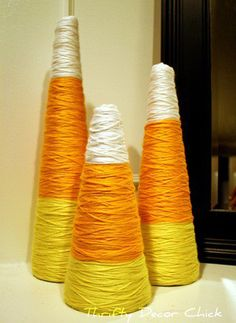 Candy corn trees made out of styrofoam cones and yarn