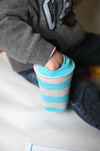 Stick a cup inside the foot of a sock and have students reach inside to pull out alphabet letters, coins or any other manipulative they're using. Makes ordinary learning activiities so much more fun. *repinned by WonderBaby.org