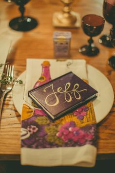 book place cards, photo by Amber Gress http://ruffledblog.com/a-styled-wedding-at-brooklyns-wythe-hotel #calligraphy #weddingideas #placesetting