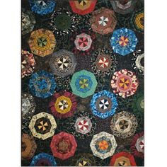 Paperweight Quilt Pattern  $8.98 at www.clotilde.com  Looks like a kaleidoscope to me....