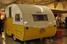 post with lots of pics of super cute vintage trailers. I must have one!
