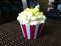 """These adorable popcorn cupcakes will be a hit at your next birthday party (think movie, circus or hollywood theme) slumber party, oscar party etc!  All you need is cupcakes, mini marshmallows, frosting, cupcake wrappers, yellow food coloring spray and some scissors!  If you like my video please subscribe as I will be posting """"how to throw a circ..."""