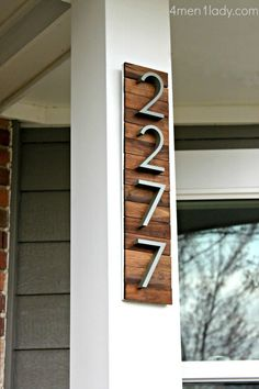 Modern house numbers.  Made the wood backing from paint stir sticks!